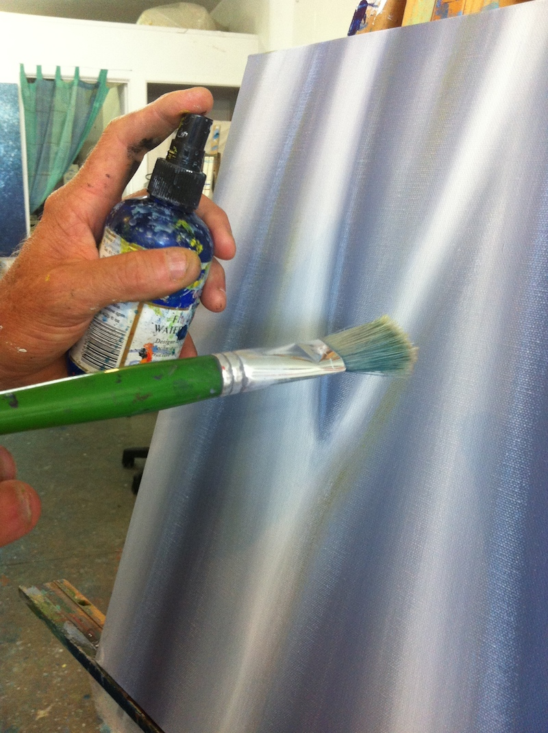 Using Atelier Unlocking Fluid to re-work dry-ish areas of your painting.