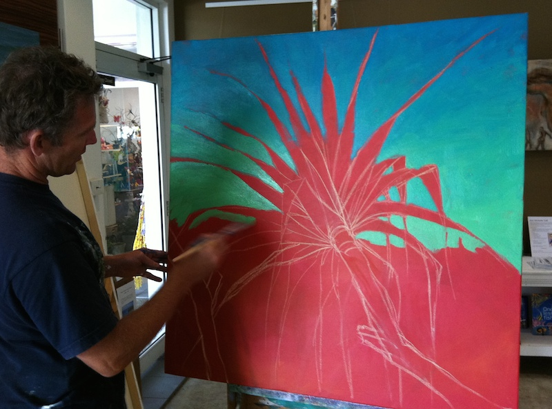 Mark paints a bright pandanus over a red ground, accentuating the contrast between foliage and background.  Gorgeous!