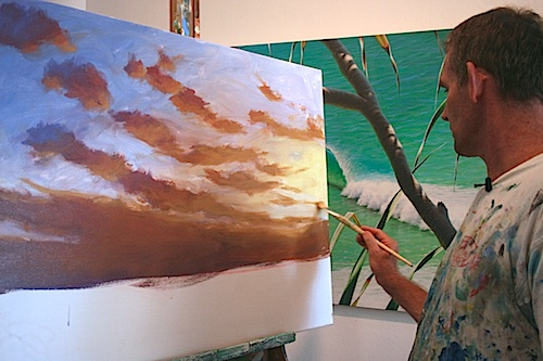 Mark in the studio painting the sunset painting demonstration for this tutorial.