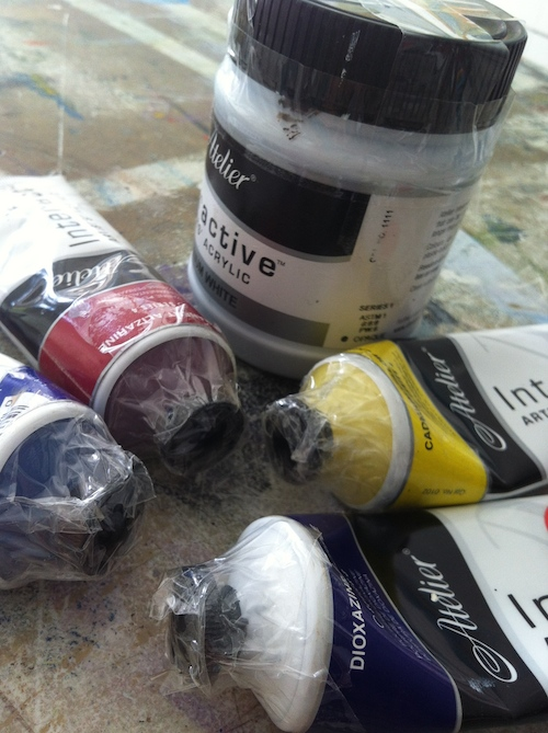 Tighten the lids of your paints and tape them up when travelling with acrylic paints.
