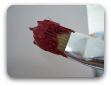 One of the 3 functions of your paintbrush, scooping the paint.