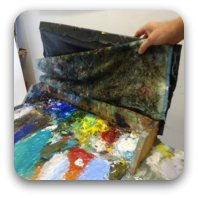 Mark's artist palette looks like a paint bomb exploded, but in actuality is very orderly and functional.